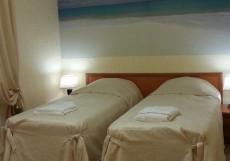 ДОМАШНИЙ ОЧАГ (Г. УХТА, ЦЕНТР ГОРОДА) Стандартный двухместный номер с 2 отдельными кроватями