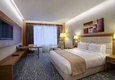 Holiday Inn Baku - Холидей Инн Баку | г. Баку | бассейн | CПА Номер с кроватью размера «king-size», боковой вид на море - Для некурящих