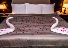 Ramada Baku Hotel - Рамада Баку Хотел | 1-линия | частный пляж | бассейн Стандартный двухместный номер с 2 отдельными кроватями и видом на сад