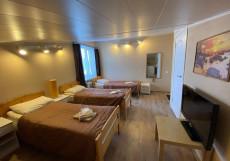 Мини-отель «Riekkalansaari» Четырехместный номер с собственной ванной комнатой