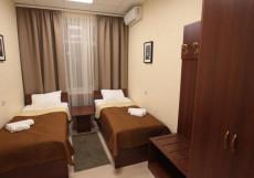 ПОБЕДА (возле воинской части) Кровать в двухместном номере с двумя отдельными кроватями