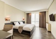 Отель Астро Плаза Улучшенный номер с кроватью размера