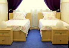 Апельсин на Преображенской Площади Двухместный номер с 2 отдельными кроватями и общей ванной комнатой